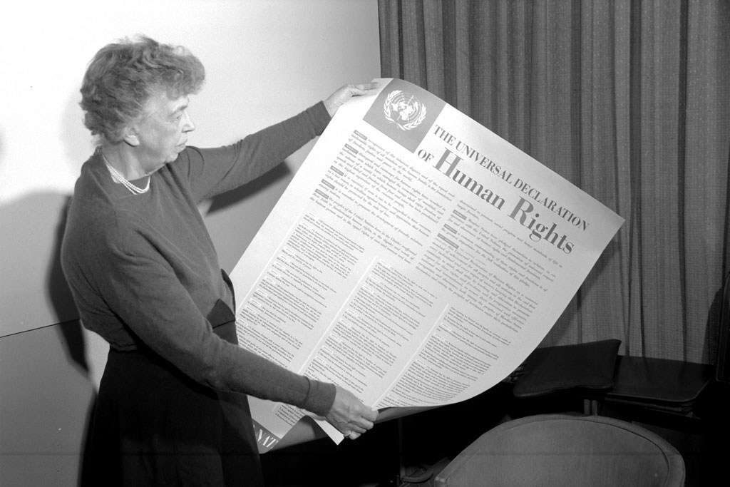Eleanor Roosevelt, USA, holding a poster depicting the Universal Declaration of Human Rights, November 1949